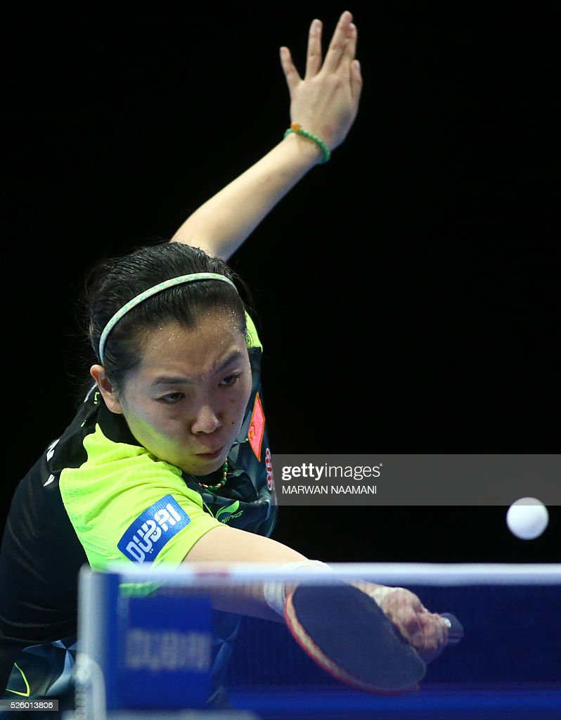 Xiaoxia Li of China returns the ball to Tianwei Feng of Singapore during their women's singles semi final table tennis match in the ITTF Nakheel Table Tennis Asian Cup, on April 29, 2016 in Dubai. / AFP / MARWAN