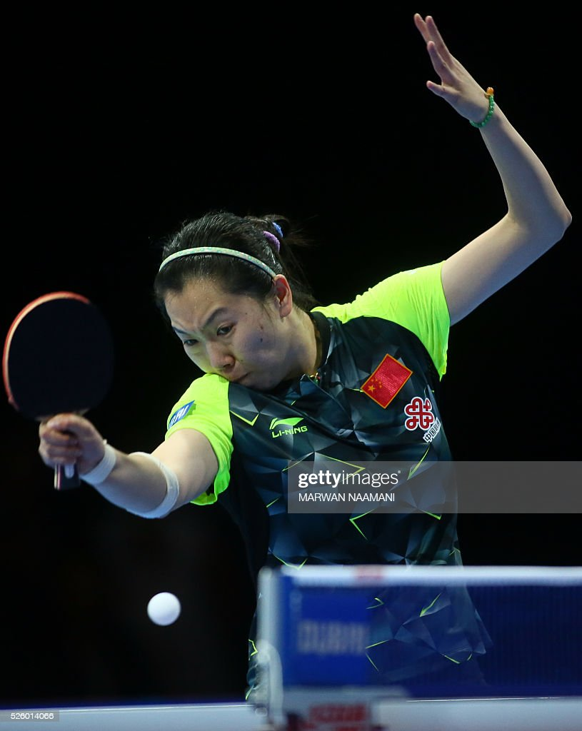 Xiaoxia Li of China returns the ball to Tianwei Feng of Singapore during their women's singles semi final table tennis match in the ITTF Nakheel Table Tennis Asian Cup, on April 29, 2016 in Dubai.. / AFP / MARWAN