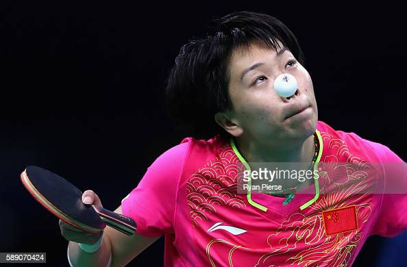 Xiaoxia Li of China serves during the Table Tennis Women's Team Quarter Final Match between China and Democratic People's Republic of Korea during...