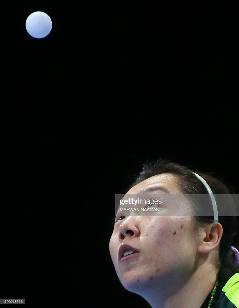 Xiaoxia Li of China serves to Tianwei Feng of Singapore during their women's singles semi final table tennis match in the ITTF Nakheel Table Tennis Asian Cup, on April 29, 2016 in Dubai. / AFP / MARWAN