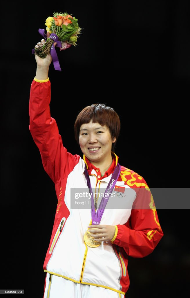 <a gi-track='captionPersonalityLinkClicked' href=/galleries/search?phrase=Xiaoxia+Li&family=editorial&specificpeople=4049514 ng-click='$event.stopPropagation()'>Xiaoxia Li</a> of China stands on the podium after winning the Gold medal in the Women's Singles Table Tennis Gold Medal match against Ning Ding of China on Day 5 of the London 2012 Olympic Games at ExCeL on August 1, 2012 in London, England.