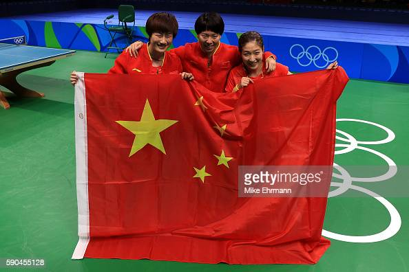 Xiaoxia Li Shiwen Liu and Ning Ding of China celebrate winning gold in the Women's Team Gold Medal Team Match between China and Germany on Day 11 of...