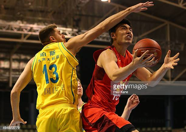 Xiaoxu Li of China goes to the basket against Tom Jervis of Australia during the 2014 SinoAustralia Challenge match between Australia and China at...