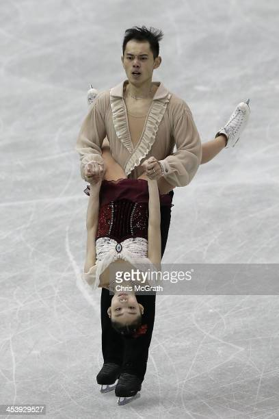Xiaoyu Yu and Yang Jin of China compete in the Junior Pairs Free Skating Final during day two of the ISU Grand Prix of Figure Skating Final 2013/2014...