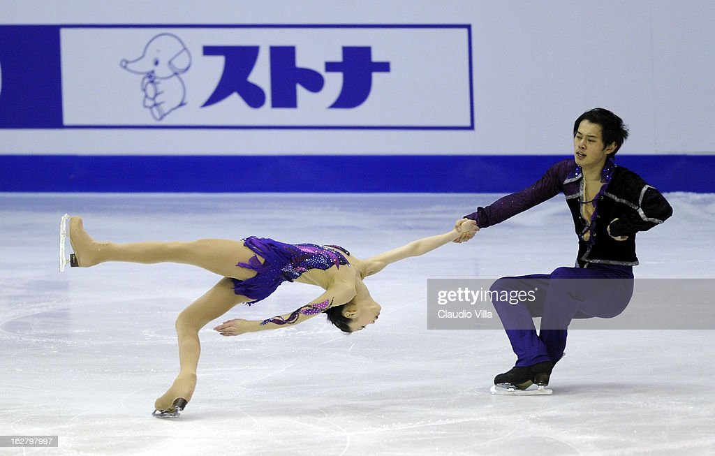 Xiaoyu Yu and Yang Jin of China skate in the Pairs Short Program during day 3 of the ISU World Junior Figure Skating Championships at Agora Arena on February 27, 2013 in Milan, Italy.