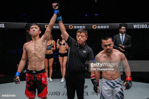 Xie Chao celebrates his win against Marc Marcellinus during ONE Championship Shanghai at the Shanghai Oriental Sports Center on September 02 2017 in...