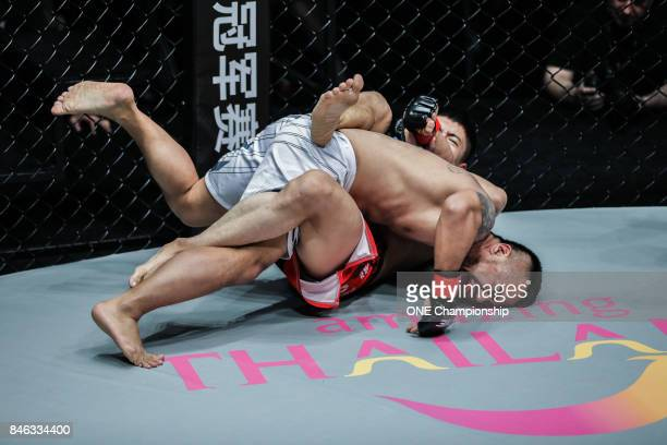 Xie Chao submits Marc Marcellinus during ONE Championship Shanghai at the Shanghai Oriental Sports Center on September 02 2017 in Shanghai China
