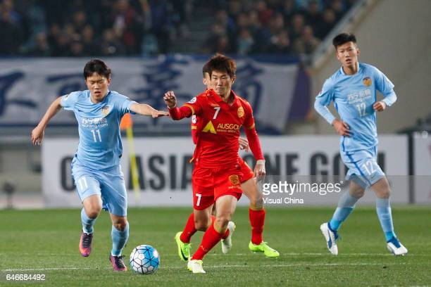 Xie Pengfei of Jiangsu Suning and Kim Jaesung of Adelaide United vie for the ball during the AFC Champions League 2017 Group H match between Jiangsu...