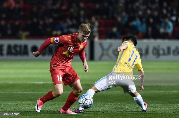 Xie Pengfei of Jiangsu Suning and Riley McGree of Adelaide United compete for the ball during 2017 AFC Champions League group match H between...