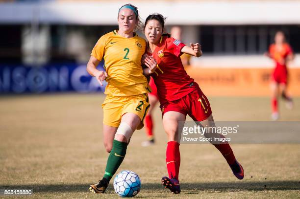 Xie Qiwen of China fights for the ball with Ellie Carpenter of Australia during their AFC U19 Women's Championship 2017 3rd and 4th placing match...