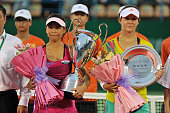 Xie Shuwei of China and Laura Robson of Great Britain pose with their trophies during the medal ceremony after the Singles Final of WTA Guangzhou...