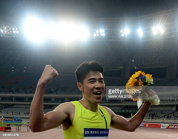 Xie Wenjun of China celebrates after winning the Men's 110m Hurdles event at the Diamond League athletics meeting in Shanghai on May 18 2014 AFP...