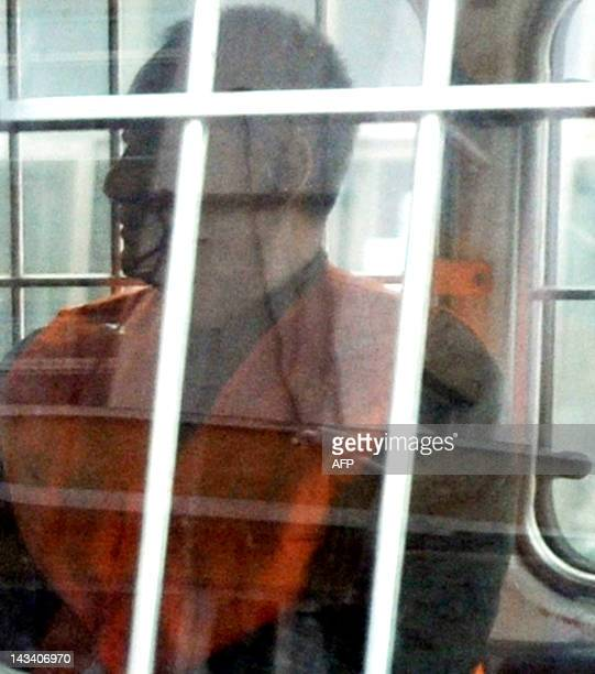 Xie Yalong the former head of the Chinese Football Association arrives in a police van at the court in Dandong northeast China's Liaoning province on...