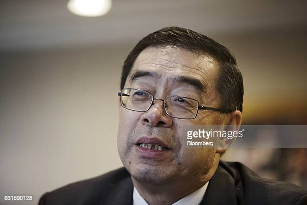 Xie Yi senior vice chairman of China agribusiness at Charoen Pokphand Group Co speaks during an interview at the company's facility in Beijing China...