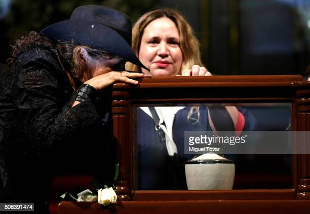 Ximena and Maria Jose daughters of Jose Luis Cuevas stand guard during an homage to Mexican artist Jose Luis Cuevas at Bellas Artes Palace on July 04...