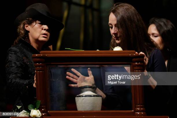 Ximena and Mariana duaghters of Jose Luis Cuevas stand guard during an homage to Mexican artist Jose Luis Cuevas at Bellas Artes Palace on July 04...