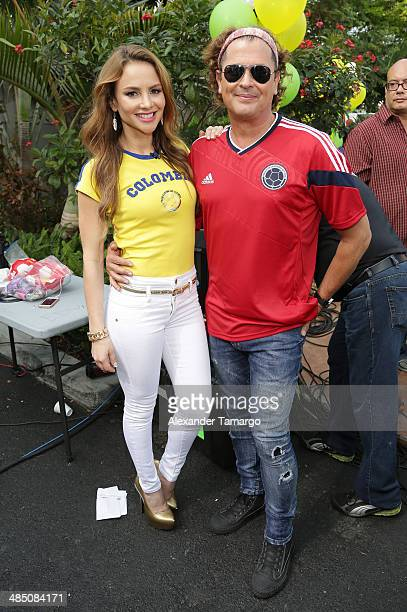 Ximena Cordoba and Carlos Vives pose during FIFA World Cup Trophy Tour on the set of Despierta America at Univision Headquarters on April 16 2014 in...
