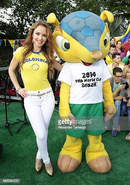 Ximena Cordoba and Fuleco pose during FIFA World Cup Trophy Tour on the set of Despierta America at Univision Headquarters on April 16 2014 in Miami...