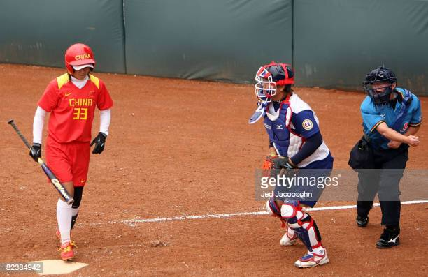 Xin Minhong of China strikes out as home plate umpire Diane Waller calls her out while taking on Chinese Taipei during the softball game at the...