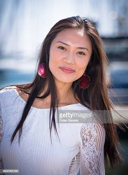 Xin Wang poses during the 'ExModel' photocall at MIPTV on April 13 2015 in Cannes France