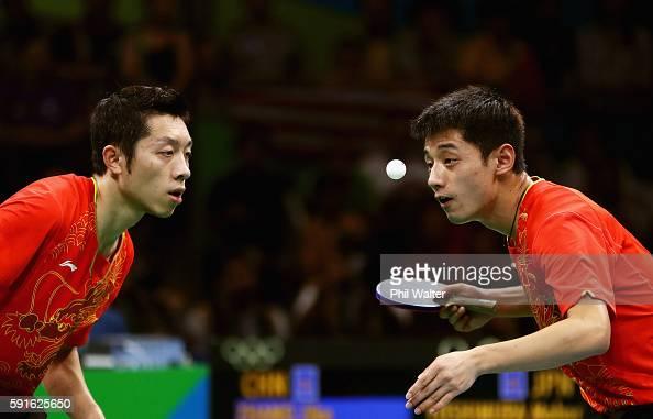 Xin Xu and Jike Zhang of China compete during the Men's Table Tennis gold medal match against Koki Niwa and Maharu Yoshimura of Japan at Riocentro...