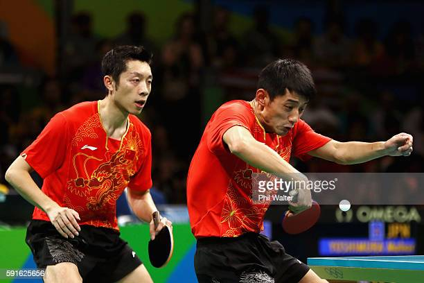Xin Xu and Jike Zhang of China compete during the Men's Table Tennis gold medal match against Koki Niwa and Maharu Yoshimura of Japan at Riocentro...