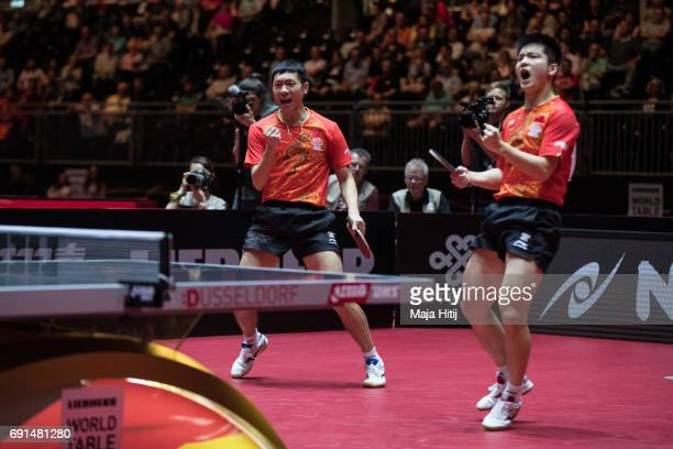 Xin Xu of China and Zhendong Fan of China react during Men's Doubles quarter finals at Table Tennis World Championship at Messe Duesseldorf on June 2...