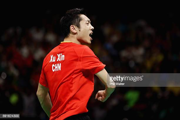 Xin Xu of China celebrates during the Men's Table Tennis gold medal match against Jun Mizutani of Japan at Riocentro Pavilion 3 on Day 12 of the Rio...