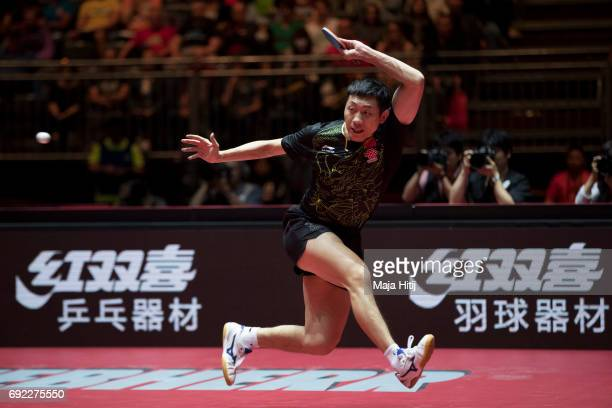 Xin Xu of China in action during Men's Singles quarter final against Tomokazu Harimoto of Japan at Table Tennis World Championship at at Messe...