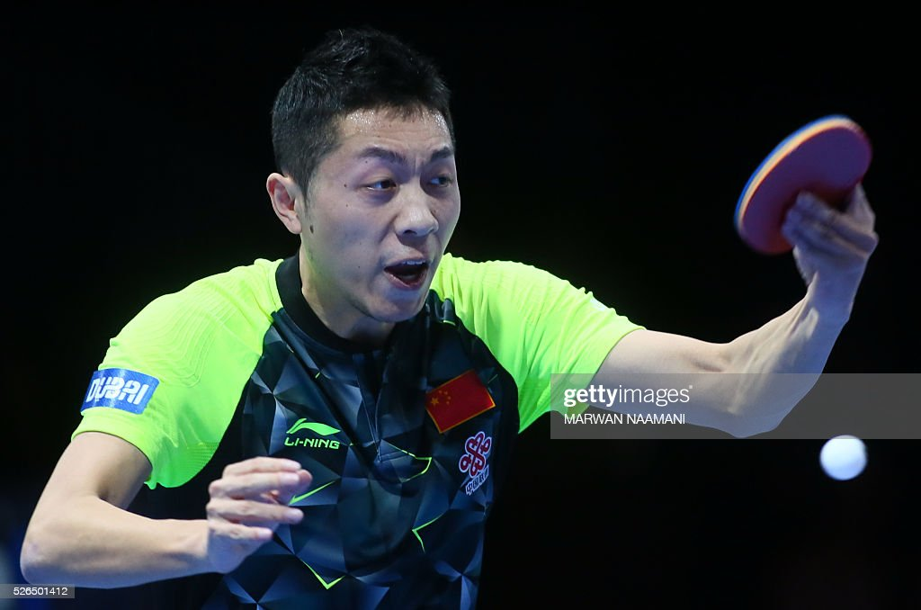 Xin Xu of China returns the ball to his countryman Jike Zhang during their men's singles semi-final table tennis match in the ITTF Nakheel Table Tennis Asian Cup, on April 30, 2016 in Dubai. / AFP / MARWAN