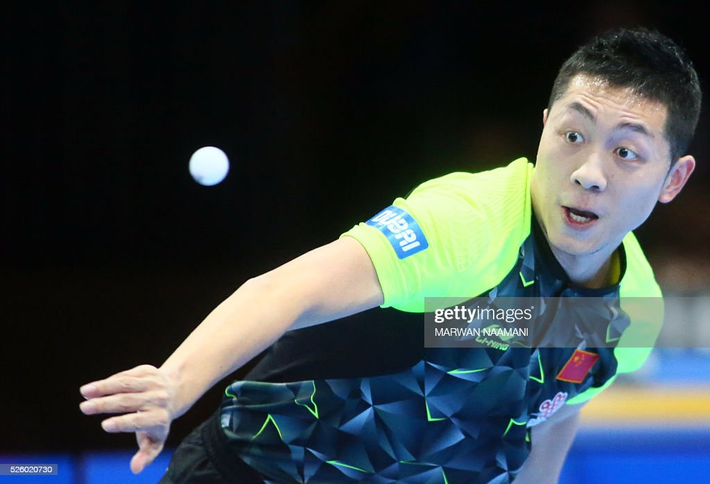 Xin Xu of China returns the ball to Ning Gao of Singapore during their men's singles semi-final table tennis match in the ITTF Nakheel Table Tennis Asian Cup, on April 29, 2016 in Dubai. / AFP / MARWAN