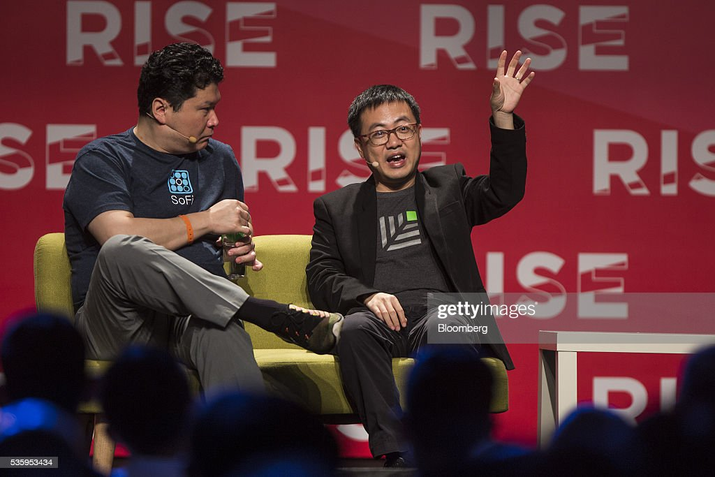Xing Liu, partner at Sequoia Capital, right, gestures while he speaks as David Chao, co-founder and general partner of DCM Ventures, listens during the Rise conference in Hong Kong, China, on Tuesday, May 31, 2016. The conference runs through June 2. Photographer: Justin Chin/Bloomberg via Getty Images