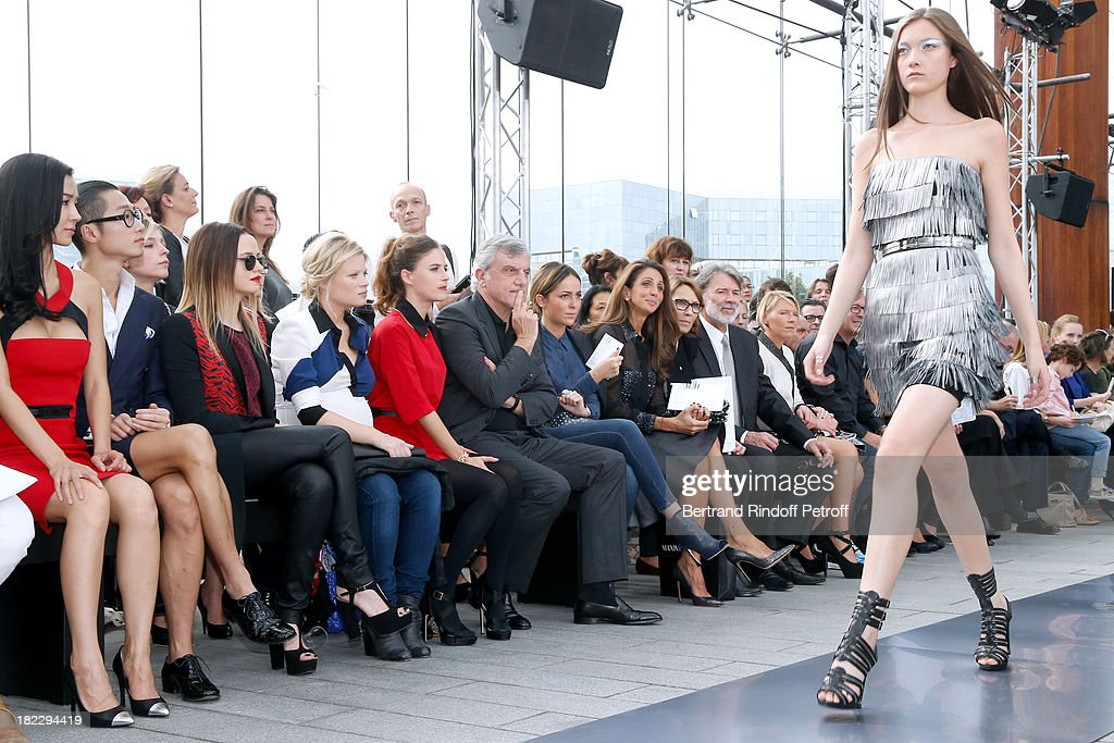 Xing Tong Yaho, Guest, Sara Forestier, Melanie Thierry, Melanie Bernier, CEO Dior Sidney Toledano, his daughter Julia Toledano, Guest, parents of Maxime Simoens, Herve Simoens and his wife attend Maxime Simoens show as part of the Paris Fashion Week Womenswear Spring/Summer 2014, held at Orangerie du parc Andre Citroen on September 29, 2013 in Paris, France.