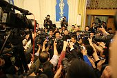 Xinjiang Communist Party Secretary Zhang Chunxian is surrounded by journalists after a group meeting during the second session of the 12th National...