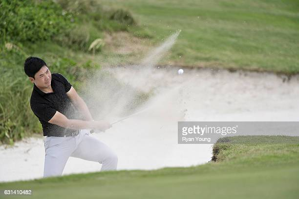 Xinjun Zhang plays a bunker shot on the 15th hole during the continuation of the second round of The Bahamas Great Exuma Classic at Sandals Emerald...
