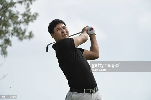 Xinjun Zhang tees off on the 16th hole during the continuation of the second round of The Bahamas Great Exuma Classic at Sandals Emerald Bay Course...