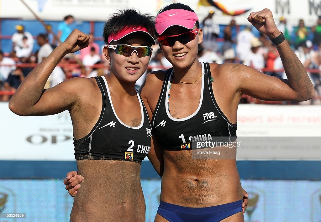 Xinyi Xia (L) and Chen Xue (R) of China after winning the Women's final between Chen Xue and Xinyi Xia of China and Julia Sude and Chantal Laboureur of Germany at the FIVB Durban Open at New Beach on December 14, 2013 in Durban, South Africa.