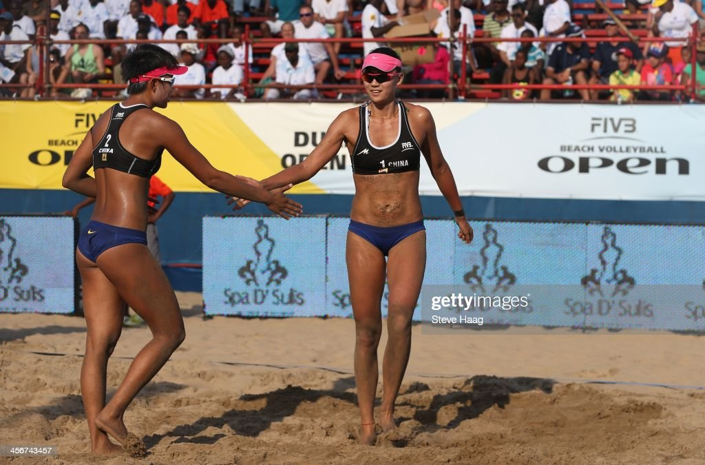 Xinyi Xia (F) and Chen Xue (B) of China after winning the Women's final between Chen Xue and Xinyi Xia of China and Julia Sude and Chantal Laboureur of Germany at the FIVB Durban Open at New Beach on December 14, 2013 in Durban, South Africa.