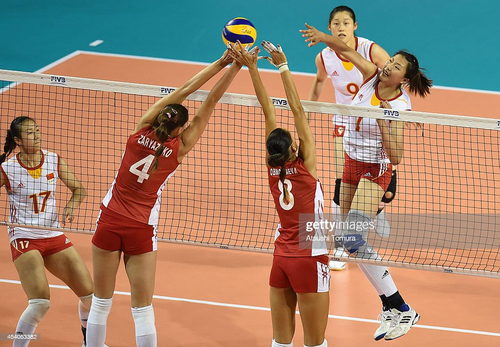 Xinyue Yuan of China spikes the ball during the FIVB World Grand Prix Final group one match between Russia and China on August 24, 2014 in Tokyo, Japan.
