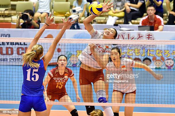 Xinyue Yuan of China spikes the ball in the match against Serbia during the FIVB Women's Volleyball World Cup Japan 2015 at Matsumoto City General...