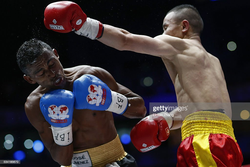 Xiong Chaozhong of China delivers a punch to Jose Jimenez of Colombia during their IBF Mini Flyweight Eliminator boxing match at Beijing Olympic park diamond stadium on May 25, 2016 in Beijing, China.