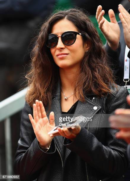 Xisca Perello girlfriend of Rafael Nadal of Spain watches as he receives his winners trophy after his straight set victory against Albert...
