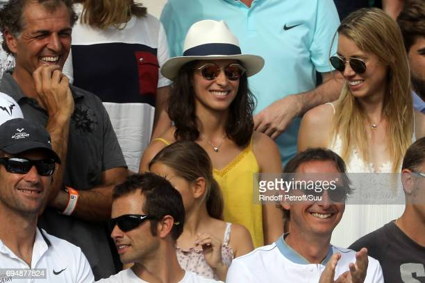 Xisca Perello girlfriend of Rafael Nadal of Spain watches on from Court Philippe Chatrier during the mens singles final match between Rafael Nadal of...