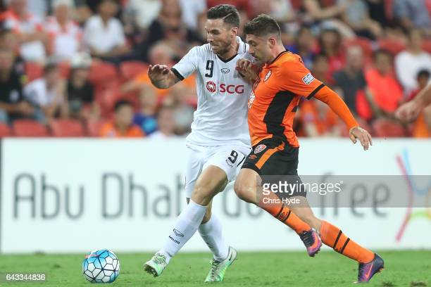 Xisco Jimenez of Muangthong United and Brandon Borrello of the Roar compete for the ball during the AFC Champions League match between the Brisbane...