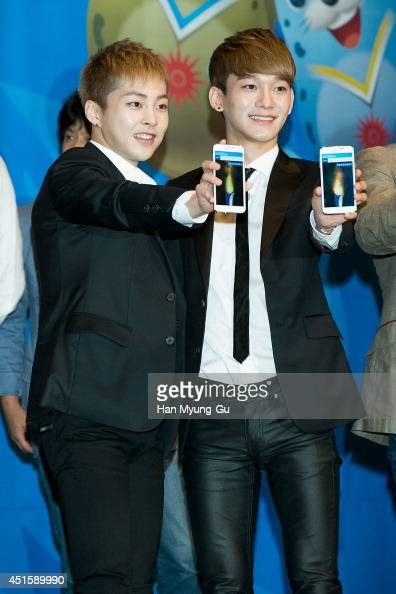 Xiumin and Chen of boy band EXOM attend the press conference for the 17th Asian Games Incheon 2014 on July 1 2014 in Seoul South Korea