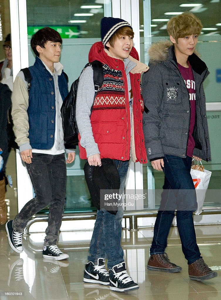 Xiumin and Lu Han of boy band EXO-M are seen at Gimpo International Airport on January 27, 2013 in Seoul, South Korea.