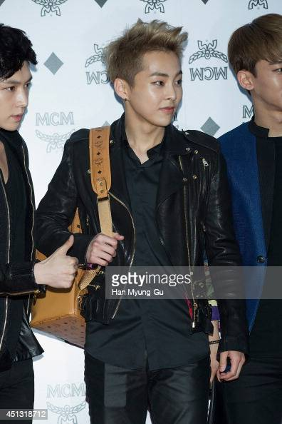 Xiumin of boy band EXOM attends the MCM Mega Concept store opening on June 26 2014 in Seoul South Korea