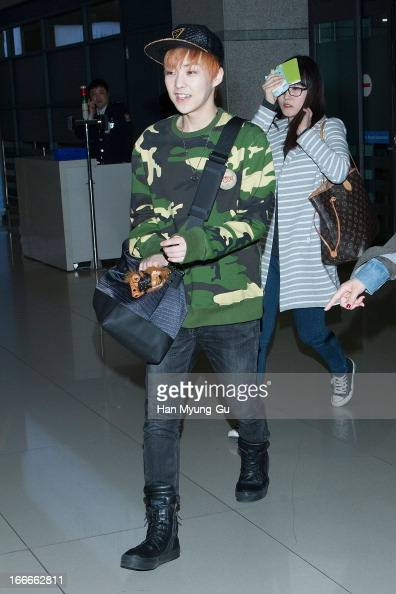 Xiumin of boy band EXOM is seen upon arrival from China at Incheon International Airport on April 15 2013 in Incheon South Korea
