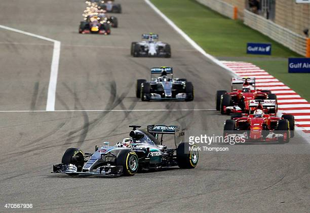 xLewis Hamilton of Great Britain and Mercedes GP leads during the Bahrain Formula One Grand Prix at Bahrain International Circuit on April 19 2015 in...