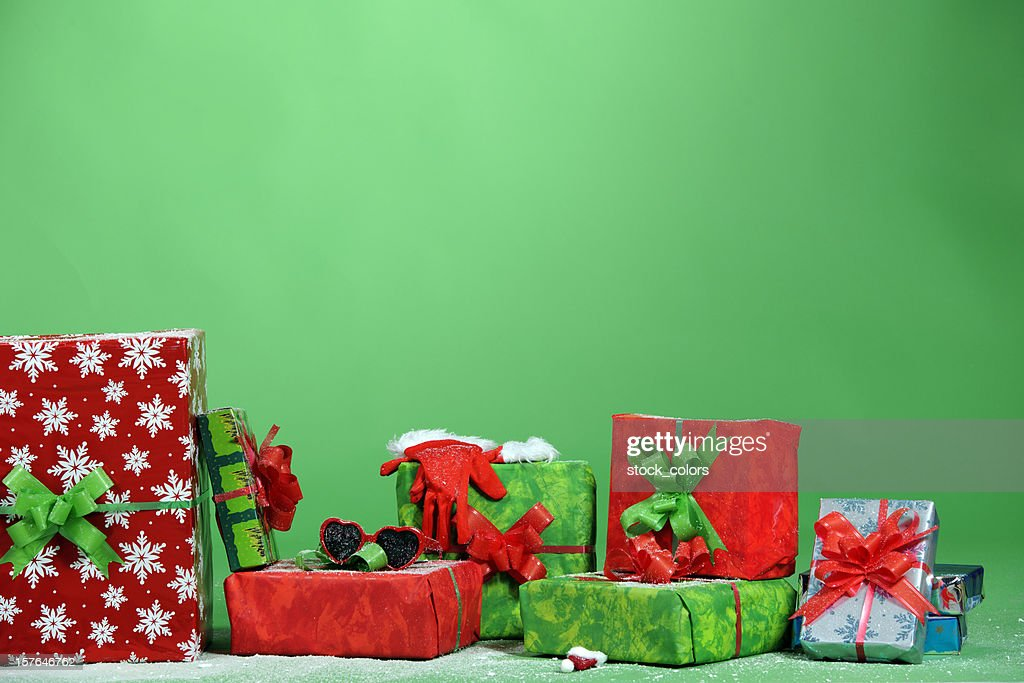 x-mas gifts on green background